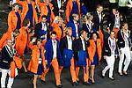Engeland, London, 27 juli 2012.Olympische Spelen London.De openingsceremonie van de Olympische Spelen in London 2012.De nederlandse deelnemers zwaaien naar het publiek tijdens hun ere ronde