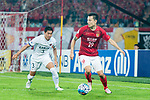 Guangzhou Forward Gao Lin (R) fights for the ball with Kashima Defender Shoji Gen (L) during the AFC Champions League 2017 Round of 16 match between Guangzhou Evergrande FC (CHN) vs Kashima Antlers (JPN) at the Tianhe Stadium on 23 May 2017 in Guangzhou, China. (Photo by Power Sport Images/Getty Images)
