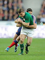 15th March 2014; Brian O'Driscoll, Ireland, is tackled by Remi Tales, France. RBS Six Nations, France v Ireland, Stade de France, St Denis, Paris. Picture credit: Tommy Grealy/actionshots.ie.