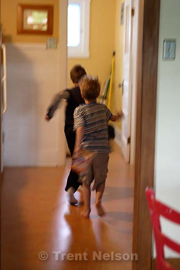 noah nelson and nathaniel nelson play-fighting.<br />