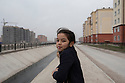 Uzbekistan - Tashkent - A young girl stands along the canal passing by Sergeli, the largest working class neighborhood of the capital.