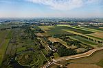 Nederland, Gelderland, Gemeente Brakel, 08-07-2010; Buitenpolder Het Munnikeland (re), gezien naar de Afgedamde Maas. Batterij Brakel in de voorgrond. In het kader van het programma Ruimte voor de Rivier zijn er plannen om de polder weer als komgebied te gaan gebruiken voor de opvang van water bij hoge waterstanden. Er komt een nieuwe dijk, parallel aan en rechts van Den Nieuwendijk (deze loopt vanaf de batterij). De Waalkade, onder in beeld, wordt verlaagd. .Polder Munnikenland (r) in the direction of the Afgedamde Maas. Brakel battery in the foreground. Under the program 'space for the river', there are plans to use the polder as retaining basin during high water. A new dike to the right of the existing dike (on the left, with trees) will be constructed. The height of the dike of the river Waal (bottom) will be reduced..luchtfoto (toeslag), aerial photo (additional fee required).foto/photo Siebe Swart