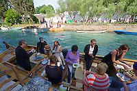 55th Art Biennale in Venice - The Encyclopedic Palace (Il Palazzo Enciclopedico).<br /> Giardini.<br /> Francesca Habsburg (4th from l.) and friends having a pick nick on a boat.