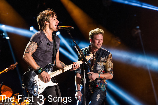Keith Urban performs with Brian Kelly of Florida Georgia Line at LP Field during Day Three of the 2014 CMA Music Festival in Nashville, Tennessee.