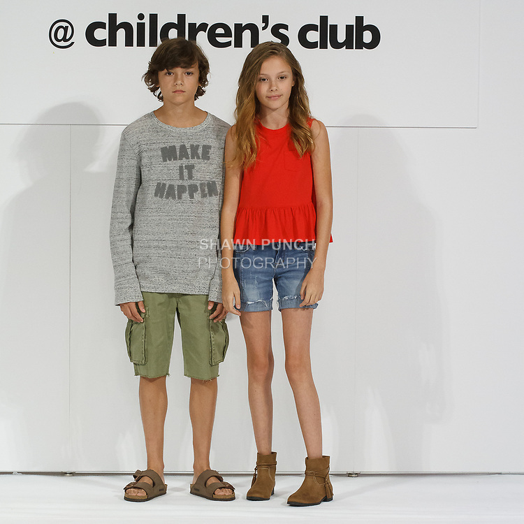 Child models pose on runway in outfits from the collection, during petitePARADE Spring Summer 2018 with Children's Club, at the Javits Center on August 6, 2017. Child models pose on runways in outfits from the Hudson Kids collection, during petitePARADE Spring Summer 2018 with Children's Club, at the Javits Center on August 6, 2017.