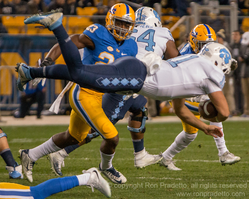 North Carolina quarterback Nathan Elliott (11) dives with the ball. The North Carolina Tarheels defeated the Pitt Panthers football team 34-31 at Heinz Field, Pittsburgh, Pennsylvania on November 9, 2017.