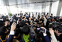 A member of Toshiba's staff is surrounded by the press at the company headquatrers on February 14, 2017, in Tokyo, Japan. Toshiba Corp. had been  scheduled to hold a press conference to announce their financial results for April to December 2016 but the conference was postponed without explanation at the last minute. Toshiba had been expected to announce details of the size of the losses from its US nuclear business. (Photo by Yohei Osada/AFLO)