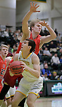 SPEARFISH, SD: DECEMBER 30:  Stefan Desnica #33 of Black Hills State goes up against Mike Nuolivirta #40 of CSU Pueblo during their game Saturday evening at the Donald E. Young Center in Spearfish, S.D.   (Photo by Dick Carlson/Inertia