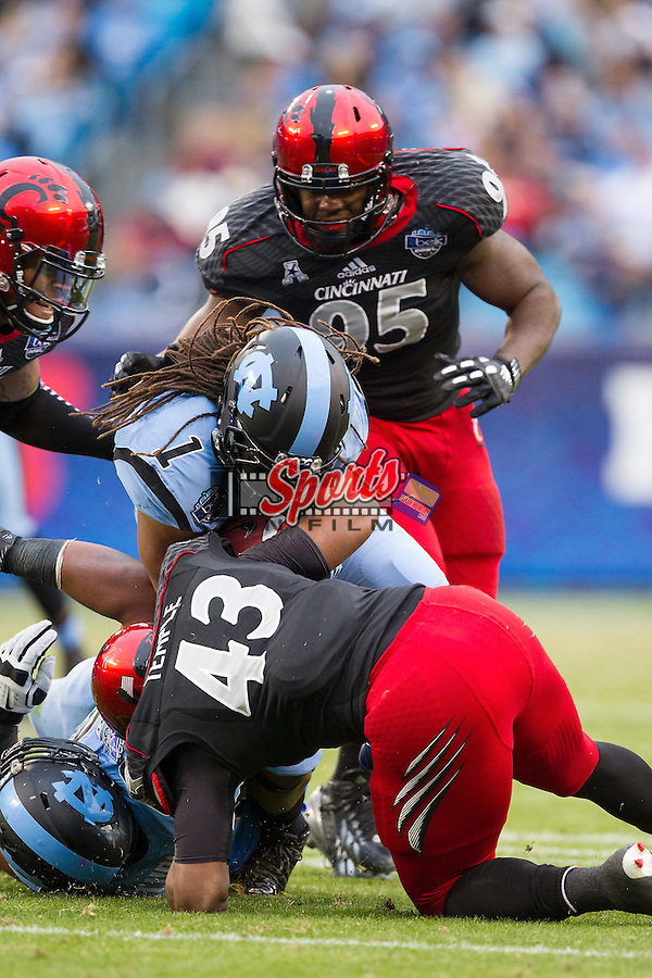 Khris Francis (1) of the North Carolina Tar Heels is tackled by Nick Temple (43) of the Cincinnati Bearcats during the Belk Bowl at Bank of America Stadium on December 28, 2013 in Charlotte, North Carolina.  The Tar Heels defeated the Bearcats 39-17.   (Brian Westerholt/Sports On Film)