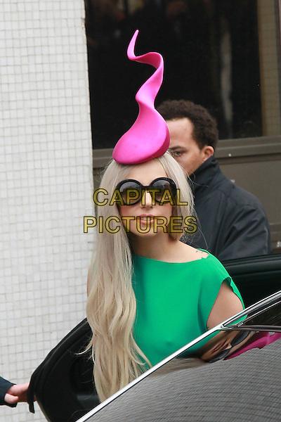 Lady Gaga (Stefani Joanne Angelina Germanotta) leaves the Lanesborough hotel for Television studios, London, England..November 16th, 2011.half length sunglasses shades pink hat green dress .CAP/HIL.©John Hillcoat/Capital Pictures .