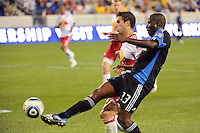 Cornell Glen (13) of the San Jose Earthquakes plays the ball as Carlos Mendes (44) of the New York Red Bulls defends. The New York Red Bulls defeated the San Jose Earthquakes 2-0 during a Major League Soccer (MLS) match at Red Bull Arena in Harrison, NJ, on August 28, 2010.