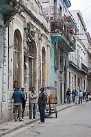 Cuba, Havana.  Street Scene, Old Havana.  Men Talking.