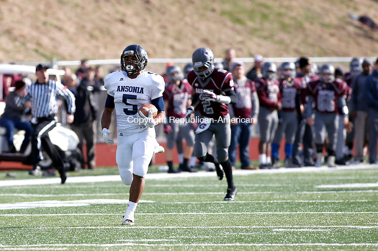 Naugatuck, CT- 26 November 2015-112615CM11-  Ansonia's Tyler Bailey (5) make his way to the end zone  during their Thanksgiving matchup against Naugatuck on Thursday.  The Chargers would rout the Greyhounds,  41-8.   Christopher Massa Republican-American