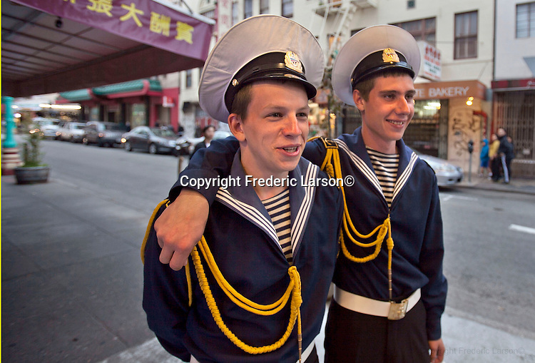 Young sailors from Russia tour San Francisco Chinatown, California....