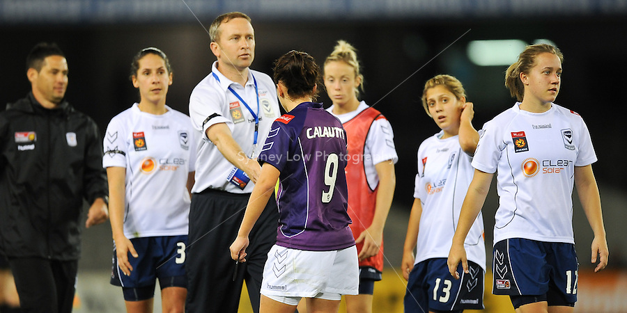 MELBOURNE, AUSTRALIA - OCTOBER 03: Dani CALAUTTI from Perth Glory shakes hands with Melbourne Victory coach Matthew SHEPHERD in round 1 of the Westfield W-league match between Melbourne Victory and Perth Glory at Etihad Stadium on 3 October 2009 in Melbourne, Australia. (Photo by Sydney Low http://syd-low.com)