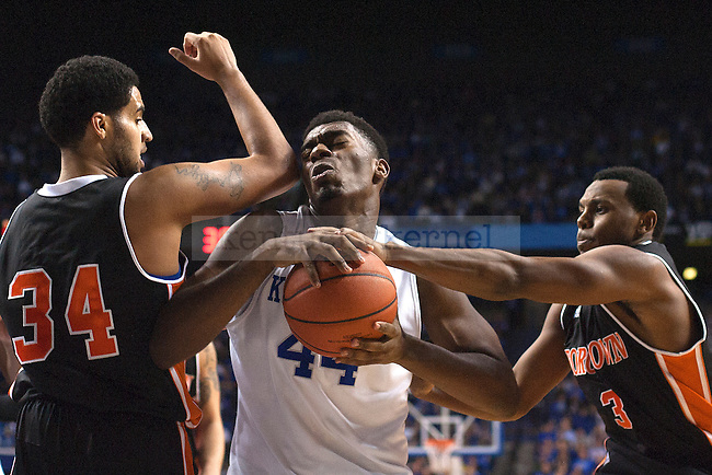 Center Dakari Johnson of the Kentucky Wildcats fights for a rebound during the second half of the game against the University of Georgetown Tigers at Rupp Arena on Sunday, November 9, 2014 in Lexington, Ky. Kentucky defeated Georgetown 121-52. Photo by Michael Reaves | Staff