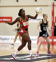24.10.2013 Malawi's Joanna Kachilika in action during the Silver Ferns V Malawi New World Netball Series played at the TSB Bank Arena in Wellington. Mandatory Photo Credit ©Michael Bradley.