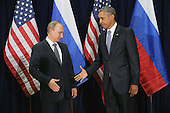 President Valdimir Putin of Russia (L) and United States President Barack Obama shake hands for the cameras before the start of a bilateral meeting at the United Nations headquarters September 28, 2015 in New York City. Putin and Obama are in New York City to attend the 70th anniversary general assembly meetings. <br /> Credit: Chip Somodevilla / Pool via CNP