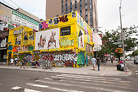 The building on the corner of Orchard and Delancey Streets in the Lower East Side neighborhood of New York on Friday, July 8, 2016 is seen festooned with approved graffiti prior to its demolition. The building was formerly the home of Moscot Opticians, since 1936, which moved across the street and Wallplay, a creative agency which organized the graffiti. The location will be come a 12 store residential.  (© Richard B. Levine)