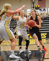 NWA Democrat-Gazette/ANDY SHUPE<br /> Sydney Hicks (right) of Gravette drives to the basket as Ashley Brannon (left) and Aspen Campbell of Pottsville defend Wednesday, Feb. 24, 2016, during the second half of play in the 4A North Regional Tournament in Tiger Arena in Prairie Grove. Visit nwadg.com/photos to see more photographs from the game.