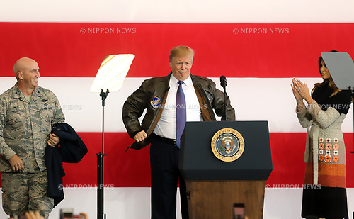 November 5, 2017, Tokyo, Japan - U.S. President Donald Trump wears a flight jacket of the 374th Airlift Wing as he delivers a speech before U.S. soldiers at the Yokota Air Base in Tokyo on Sunday, November 5, 2017. Trump arrived here on a three0day official visit to Japan for the first leg of his Asian tour.    (Photo by Yoshio Tsunoda/AFLO) LWX -ytd-