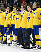 Anton Rodin (Sweden - 18), Anton Lander (Sweden - 16), Marcus Johansson (Sweden - 11), Tim Erixon (Sweden - 4), Oliver Ekman Larsson (Sweden - 3), David Rundblad (Sweden - 7) - Team Sweden celebrates after defeating Team Switzerland 11-4 to win the bronze medal in the 2010 World Juniors tournament on Tuesday, January 5, 2010, at the Credit Union Centre in Saskatoon, Saskatchewan.