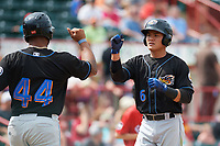 Akron RubberDucks shortstop Yu-Cheng Chang (6) fist bumps Bobby Bradley (44) after hitting a home run during a game against the Erie SeaWolves on August 27, 2017 at UPMC Park in Erie, Pennsylvania.  Akron defeated Erie 6-4.  (Mike Janes/Four Seam Images)