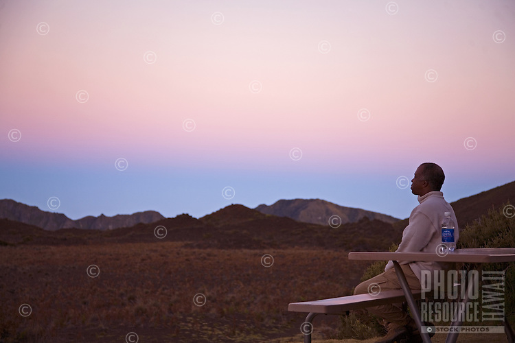Man meditating at sunrise in the Halekala crater