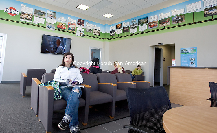 MIDDLEBURY, CT. 20 February 2012-021812SV12-Sandra Mendoza of Thomaston relaxes in the new service center lounge at County Line Auto in Middlebury Monday. County Line Auto in Middlebury opened a new service center that will contain a little something extra for customers. Every day, customers will be able to take advantage of a different service provider, like a massage therapist, a manicurist, a fortune teller, a caricature or portrait artist, a tax accountant, while waiting for their car to be serviced..Steven Valenti Republican-American
