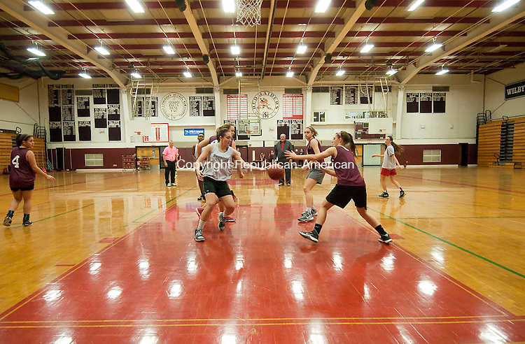 TORRINGTON, CT--- -120215JS05--Torrington girl's basketball team runs drills during pre-season conditions and practice Wednesday at the high school. Jim Shannon Republican-American