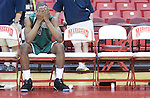 The Gazette Surrattsville High School senior guard Ifadeyo Olasupo buries his face in his hands out of frustration after his team's loss in the Maryland state 1A finals against Snow Hill High School at Comcast Center in College Park on Saturday afternoon.