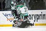 Stockholm 2014-03-21 Ishockey Kvalserien AIK - R&ouml;gle BK :  <br /> domare Simon Hillborg domare Petter Norman &aring;ker in i jublande R&ouml;gle spelare efter att R&ouml;gles Jakob Johansson gjort 1-0<br /> (Foto: Kenta J&ouml;nsson) Nyckelord:  jubel gl&auml;dje lycka glad happy domare referee ref