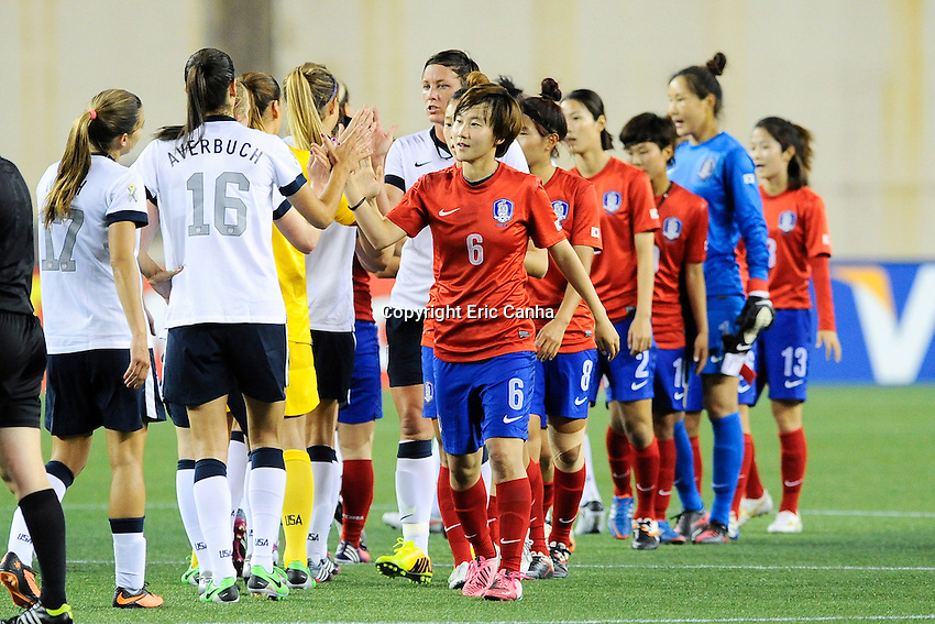 The US Women's National and Korea Republic teams at the end of  the International Friendly soccer match between the USA Women's National team and the Korea Republic Women's Team held at Gillette Stadium in Foxborough Massachusetts.   Eric Canha/CSM