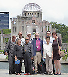 Several members of a World Council of Churches delegation pose in front of the ruins of a building damaged in the 1945 bombing of Hiroshima, Japan. The pilgrims came to Hiroshima in August 2015 for the 70th anniversary of the bombing to listen to survivors and recommit themselves to new forms of advocacy for a world free of nuclear weapons.