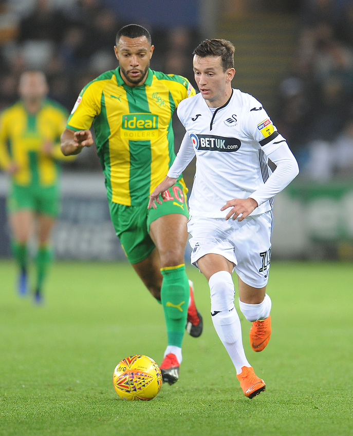 Swansea City's Bersant Celina under pressure from West Bromwich Albion's Matt Phillips<br /> <br /> Photographer Kevin Barnes/CameraSport<br /> <br /> The EFL Sky Bet Championship - Swansea City v West Bromwich Albion - Wednesday 28th November 2018 - Liberty Stadium - Swansea<br /> <br /> World Copyright © 2018 CameraSport. All rights reserved. 43 Linden Ave. Countesthorpe. Leicester. England. LE8 5PG - Tel: +44 (0) 116 277 4147 - admin@camerasport.com - www.camerasport.com