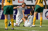 USWNT forward (20) Abby Wambach celebrates her game-winning goal with teammate (7) Shannon Boxx during the Peace Queen Cup  in Suwon, South Korea.  The U.S. defeated Australia, 2-1, at the Suwon Sports Complex.