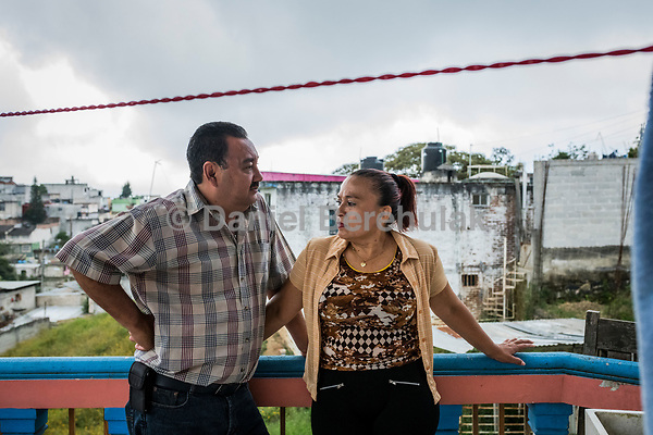 Carlos Saldana and Vicky Delgadillo stand on the balcony as they attend a birthday party for their grandson, Hector Yael, 10, at a family gathering at Vicky's daughter, Cinthia Hernández Delgadilo's house in Xalapa, Mexico on November 4, 2017. <br /> Photo Daniel Berehulak for The New York Times