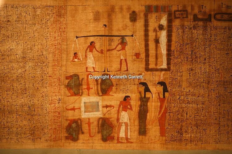 Goddess Maat painted on funerary Papyrus,Tutankhamun and the Golden Age of the Pharaohs,Tutankhamun, Exhibit, Catalog, New Kingdom, Egypt, Golden Age of the Pharaohs, Goddess, Maat, Papyrus, artifact, archaeology, Egyptian Museum, Cairo