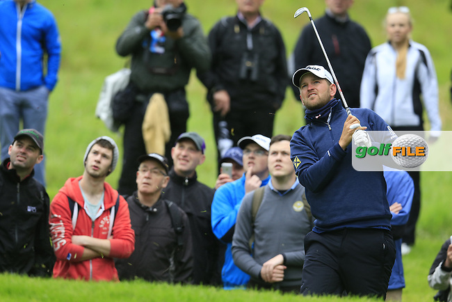 Bernd Wiesberger (AUT) plays his 2nd shot on the 17th hole during Thursday's Round 1 of the 2016 Dubai Duty Free Irish Open hosted by Rory Foundation held at the K Club, Straffan, Co.Kildare, Ireland. 19th May 2016.<br /> Picture: Eoin Clarke | Golffile<br /> <br /> <br /> All photos usage must carry mandatory copyright credit (&copy; Golffile | Eoin Clarke)