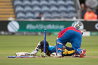 Mohammad Shahzad (Afghanistan) flattens the stumps running out Thisara Perera (Sri Lanka) during Afghanistan vs Sri Lanka, ICC World Cup Cricket at Sophia Gardens Cardiff on 4th June 2019