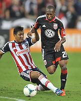 Sainey Nyassi (27) of D.C. United goes against Omar Esparza (6) of C.D. Guadalajara. C.D.Guadalajara tied D.C. United 1-1 during and international friendly, at RFK Stadium, Friday July 12, 2013.