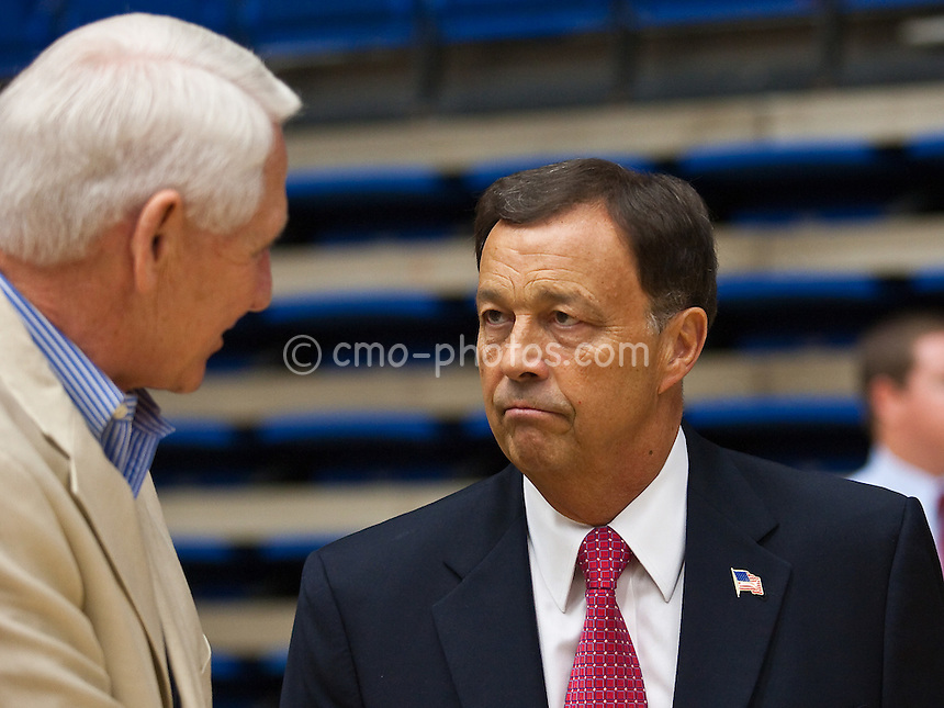 Apr 7, 2009; Tucson, AZ, USA; Arizona Wildcats athletics director Jim Livengood (right) speaks with former head basketball coach Lute Olson (left) prior to a press conference to introduce the university's new head basketball coach Sean Miller (not pictrued) at the McKale Center.