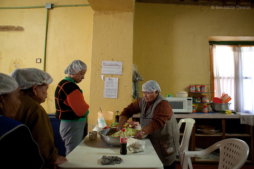 Laeticia serves the lunch to the residents of Casa Xochiquetzal in Mexico City, Mexico on October 4, 2010. Casa Xochiquetzal is a shelter for elderly sex workers in Mexico City. It gives the women refuge, food, health services, a space to learn about their human rights and courses to help them rediscover their self-confidence and deal with traumatic aspects of their lives. Casa Xochiquetzal provides a space to age with dignity for a group of vulnerable women who are often invisible to society at large. It is the only such shelter existing in Latin America. Photo by Bénédicte Desrus
