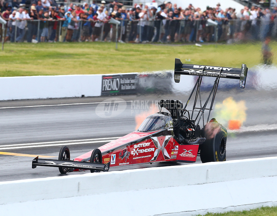 May 31, 2014; Englishtown, NJ, USA; NHRA top fuel driver Spencer Massey during qualifying for the Summernationals at Raceway Park. Mandatory Credit: Mark J. Rebilas-
