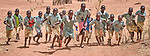 Children run in Lugi, a village in the Nuba Mountains of Sudan. The area is controlled by the Sudan People's Liberation Movement-North, and frequently attacked by the military of Sudan.