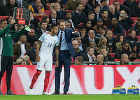 England Caretaker Manager (Head Coach) Gareth Southgate brings on Theo Walcott (Arsenal) of England in place of Adam Lallana (Liverpool) of England during the International Friendly match between England and Spain at Wembley Stadium, London, England on 15 November 2016. Photo by Andy Rowland.