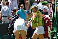 England, London, June 30, 2015, Tennis, Wimbledon, Kiki Bertens (NED) passes Petra Kvitova (CZE) to leave the court after losing<br /> Photo: Tennisimages/Henk Koster
