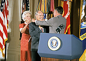 United States President George H.W. Bush and first lady Barbara Bush present the Presidential Medal of Freedom to US Secretary of Defense Dick Cheney during a ceremony in the East Room of the White House in Washington, DC on July 3, 1991. Secretary Cheney is being honored for his efforts to ensure the success of Operation Desert Shield / Operation Desert Storm and the liberation of Kuwait.<br /> Credit: Ron Sachs / CNP