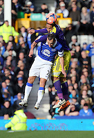 Pictured: Ashley Williams of Swansea heads the ball over Tony Hibbard of Everton. Sunday 16 February 2014<br />