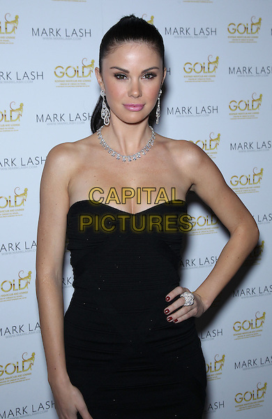 Jayde Nicole.Mark Lash 2011 Jewelry Showcase at Gold Nightclub inside Aria Hotel at CityCenter, Las Vegas, Nevada, USA..November 5th, 2011.half length black strapless dress ponytail hand on hip diamond necklace cleavage .CAP/ADM/MJT.© MJT/AdMedia/Capital Pictures.